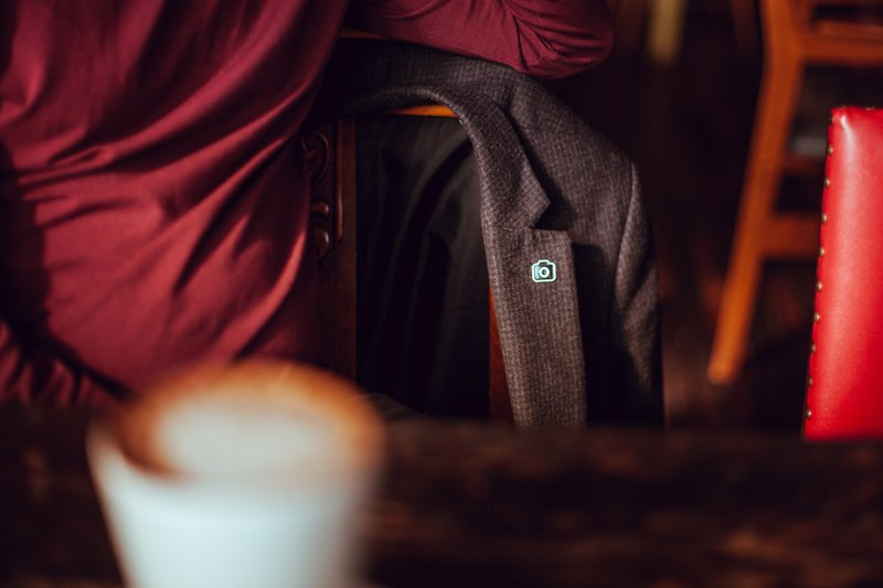 A Blazer with An Unsplash Pin, Hanging on A Chair At