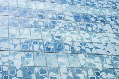 A Blue Facade with Geometric Shapes Painted on the Windows