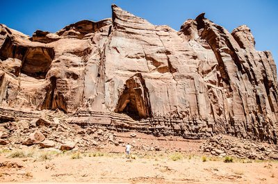 A Cave In The Side Of A Sandstone Hill In The Desert