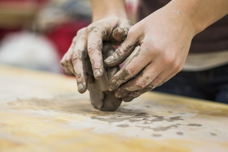 A Clay Stained Hand of A Potter Engaging in A Craft
