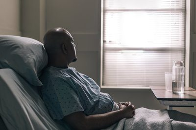 A Hospital Patient Stares Out Window Of Room