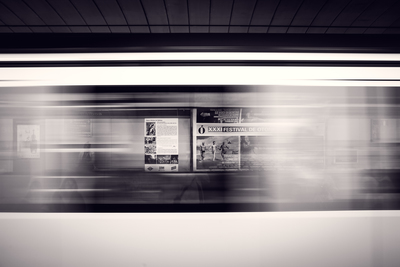 A Long-Exposure Shot of A Moving Subway Train And Advertisement Posters
