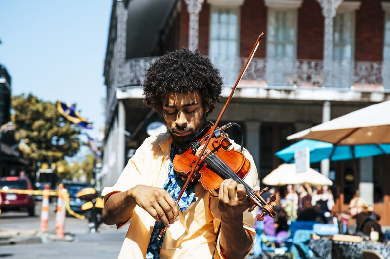 A Man Playing the Violin Or Fiddle on the Streets in