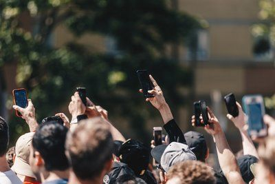 A Protest In the Street Holds Up Mobile Phones