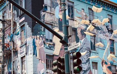A Street Mural Depicts Musicians And Others