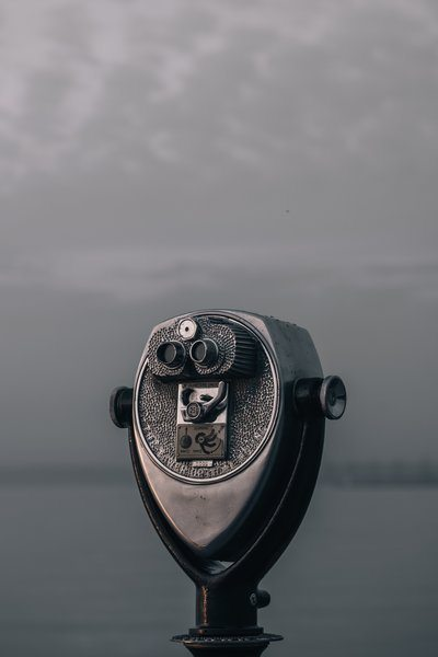 A Tower Viewer Overlooks A Watery Grey Shoreline
