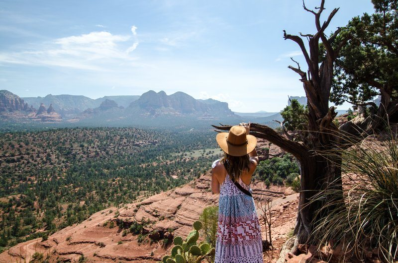 A Woman By A Tree Looks Down Over Valley