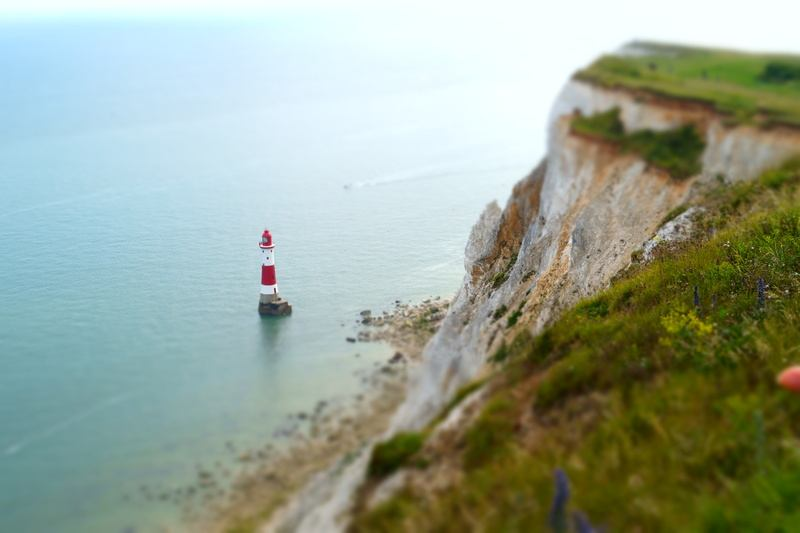 Aerial  Red And White Lighthouse on Rock