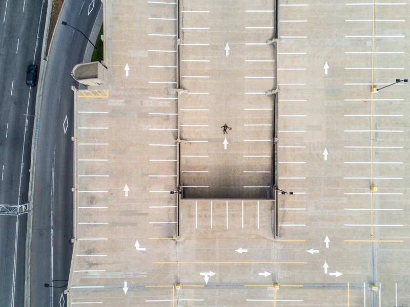 Aerial Shot Of Person Atop Parking Lot