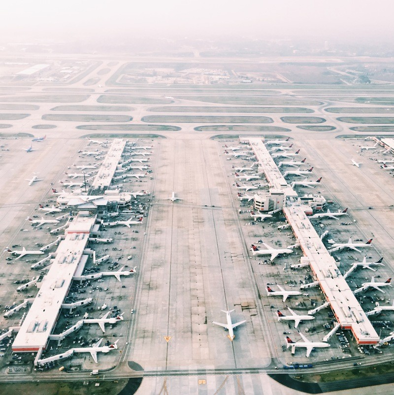 Aerial View of Airport with Lots of Airplanes