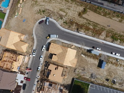Aerial View of Vehicles on Asphalt Road