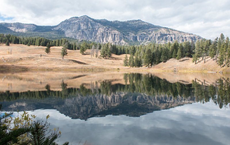 Alpine Lake Becomes A Natural Mirror