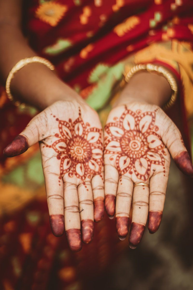 An Indian Woman In Robes Presents Henna-Painted Palms