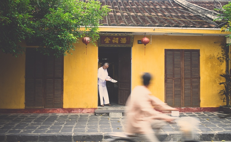 Asian House with A Man in the Door And Another Man