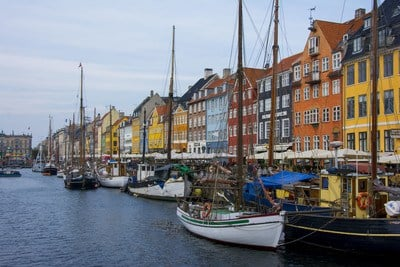Assorted-Color Boats Beside Assorted-Color Buildings