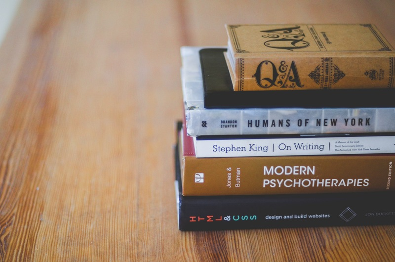 Assorted Reading Books on Table