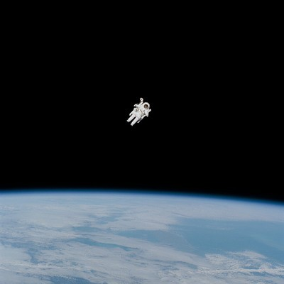 Astronaut in Spacesuit Floating in Space