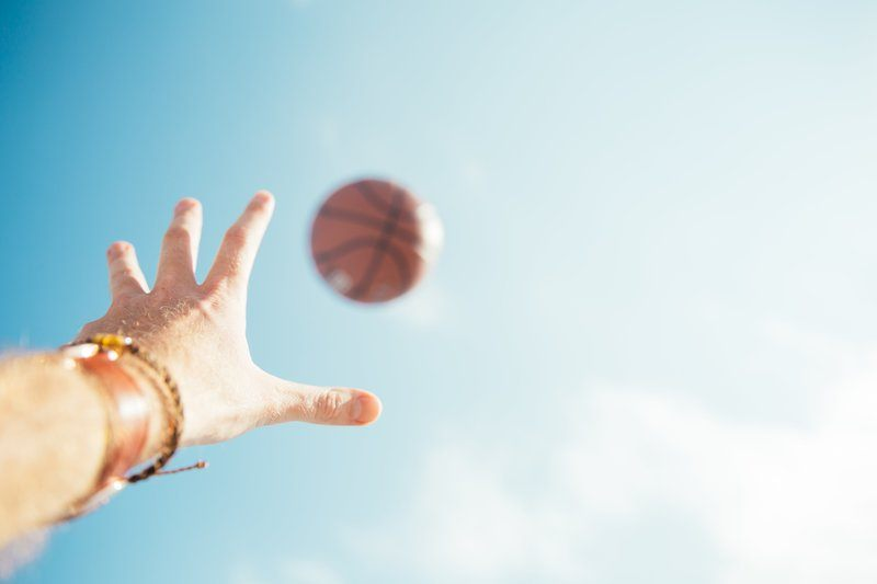 Basketball and Hand in Sky