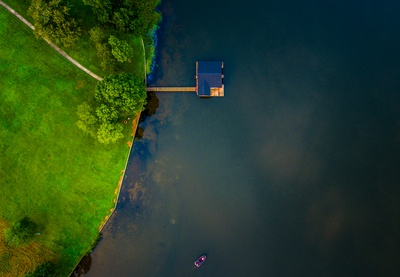 Bird's Eye View of Blue Wooden House in Water