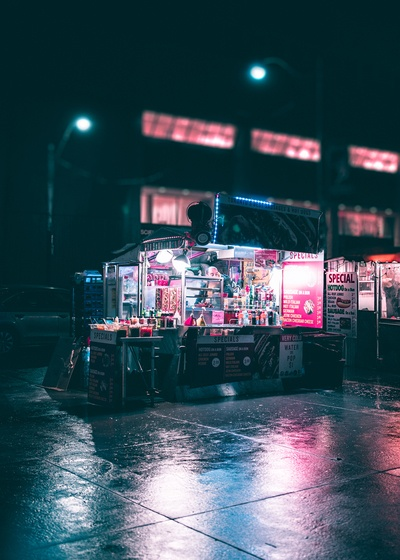 Black And Gray Food Stand at Nighttime