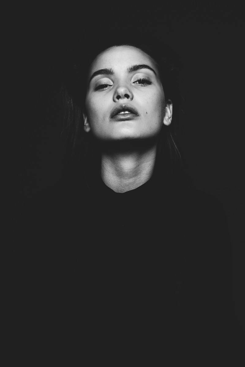 Black And White of Woman Looking Upward