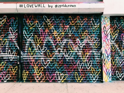 Black Door Shutter Filled with Heart Murals