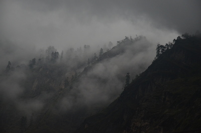 Black Mountain Surrounded By Fog
