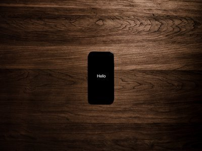 Black Smartphone Displays The Word Hello