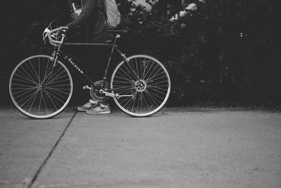 Black & White  Person Holding A Bicycle