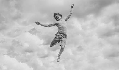 Black & White  Person Jumping Overlooking Clouds