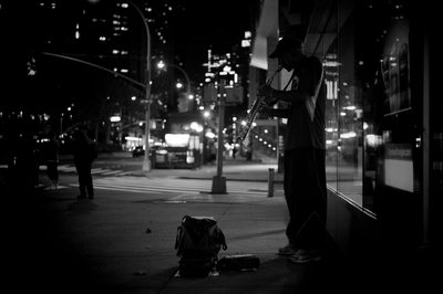 Black & White Photography of Man Playing Musical instrument Beside Road