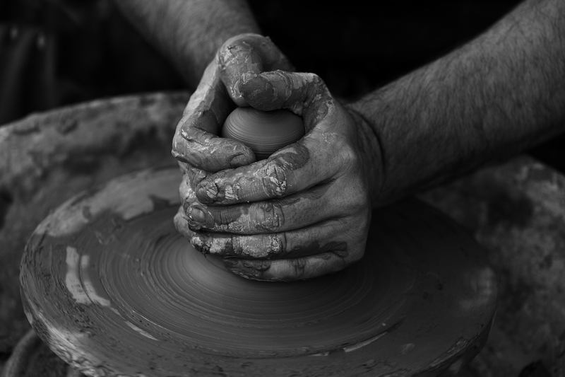 Black & White Photography of Person's Hand Making Pot