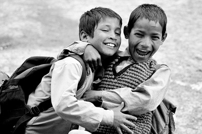 Black & White Photography of Two Boys Hugging While Laughing