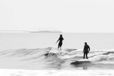 Black & White Photography of Two Person Surfing