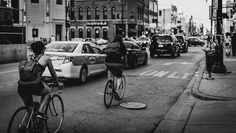 Black & White  Two Person Riding Bicycle on Road