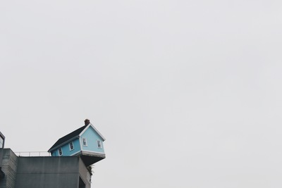 Blue Concrete Storey House on Top of Building