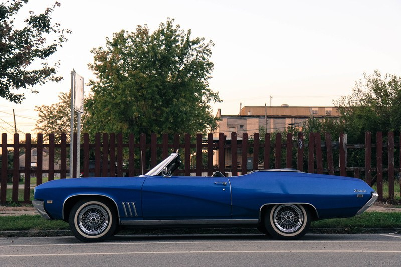 Blue Convertible Coupe on Street
