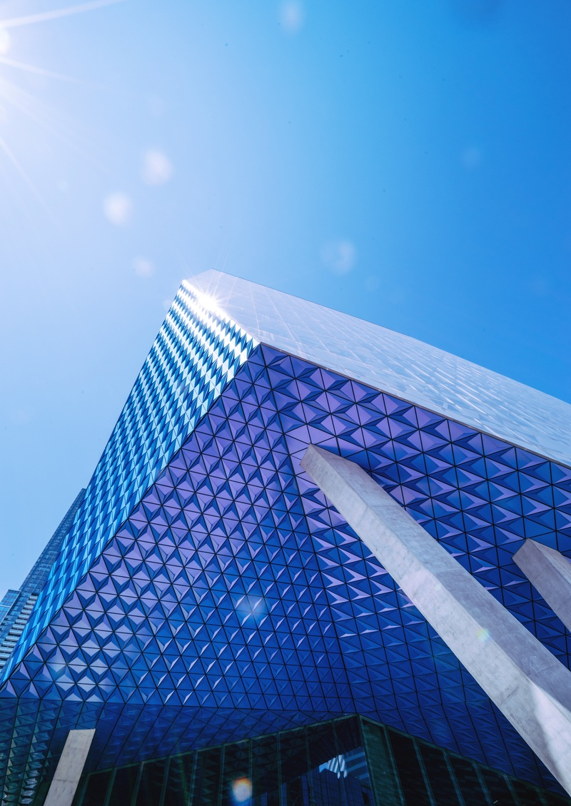 Blue Glass Walled Building Under Blue Skies
