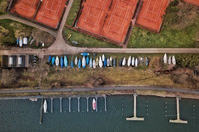 Boats Covered Beside A Dock And Tennis Courts
