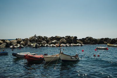 Boats In a Rocky Cove