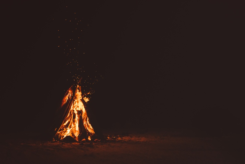 Bonfire on Brown Sand at Nighttime