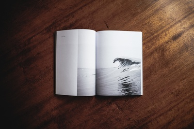 Book Opened on Brown Wooden Table