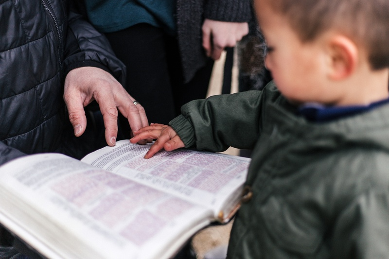 Boy Touching Page of Book