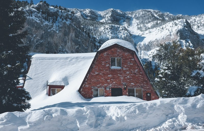 Brown Brick House Covered with Snow