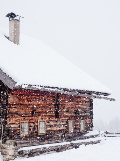 Brown Wooden House Filled with Snow During Snow