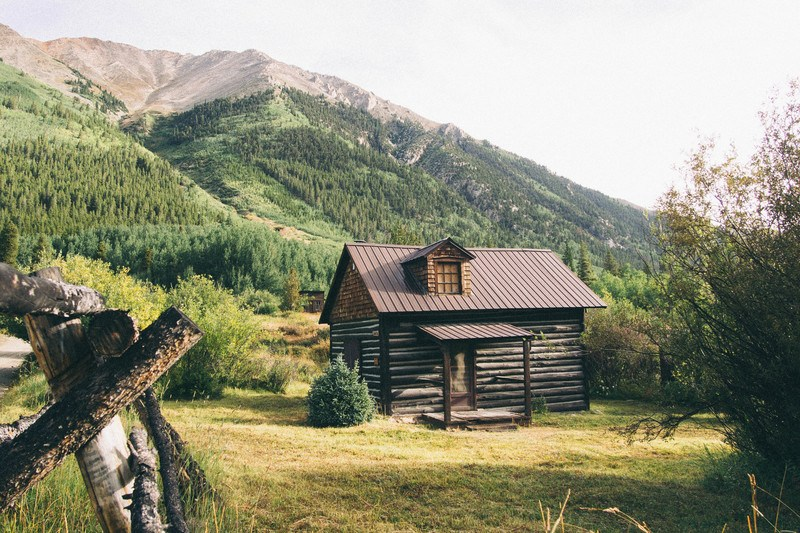 Brown Wooden House Near Mountains