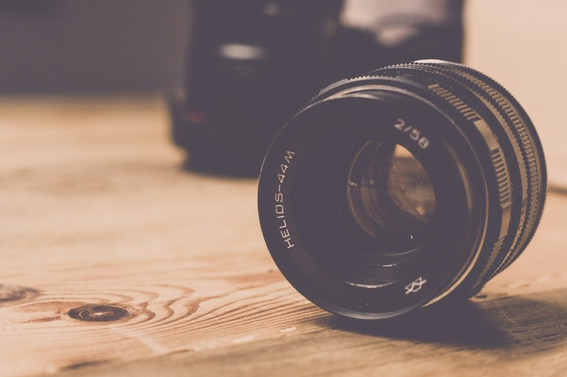 Camera Lens on Wooden Table