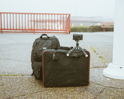 Camera Mounted on Tripod on Top of Luggage Bag