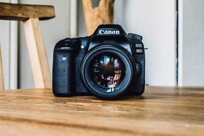 Canon Dslr Camera on Brown Wooden Table