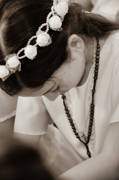 Child praying after her First Communion